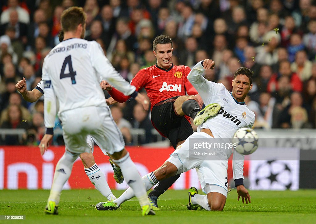 Robin van Persie of Manchester United and Raphael Varane of Real Madrid battle for the ball during the UEFA Champions League Round of 16 first leg match between Real Madrid and Manchester United at Estadio Santiago Bernabeu on February 13, 2013 in Madrid, Spain.