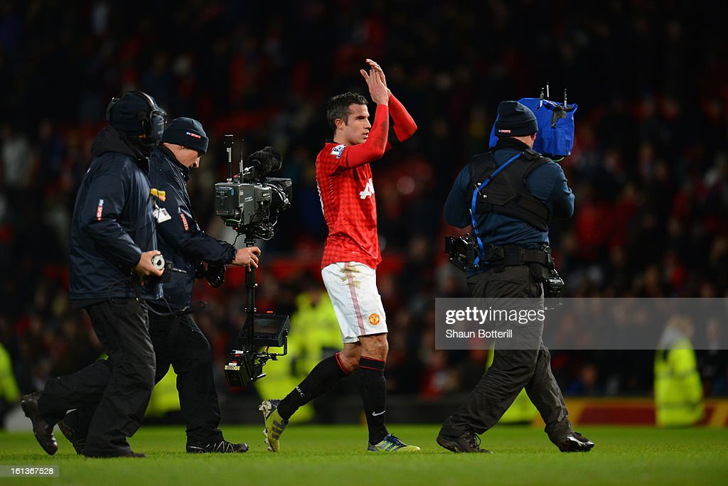 Robin van Persie of Manchester United appaluds the fans at the end of the Barclays Premier League match between Manchester United and Everton at Old Trafford on February 10, 2013 in Manchester, England.