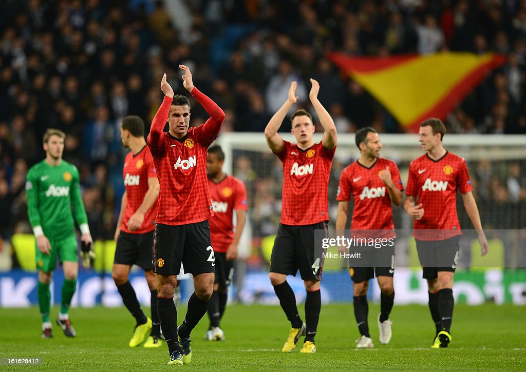 Robin van Persie of Manchester United applauds the fans at vthe final whistle during the UEFA Champions League Round of 16 first leg match between Real Madrid and Manchester United at Estadio Santiago Bernabeu on February 13, 2013 in Madrid, Spain.