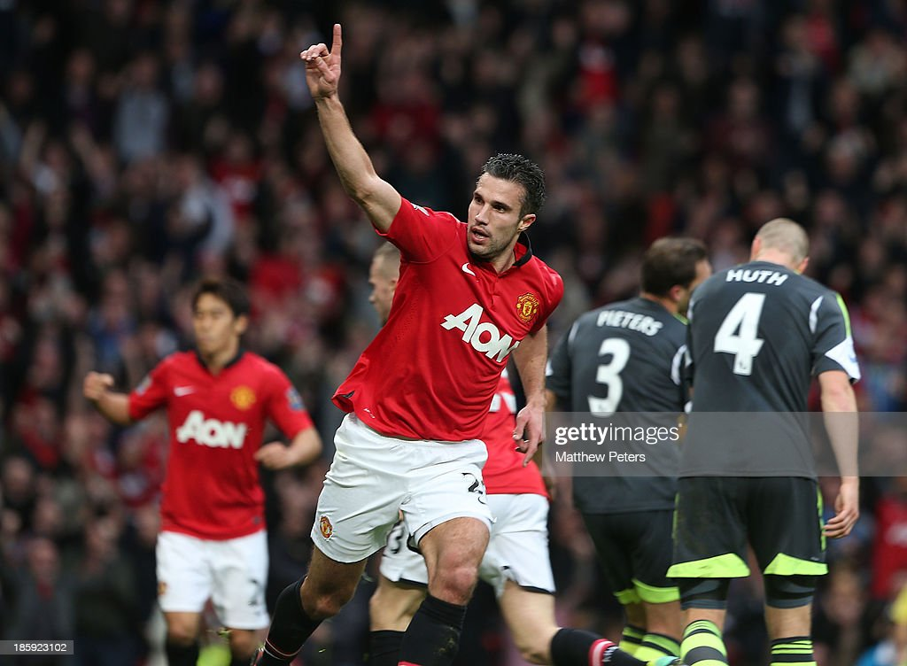 Robin van Persie of Manchester United celebates scoring their first goal during the Barclays Premier League match between Manchester United and Stoke City at Old Trafford on October 26, 2013 in Manchester, England.