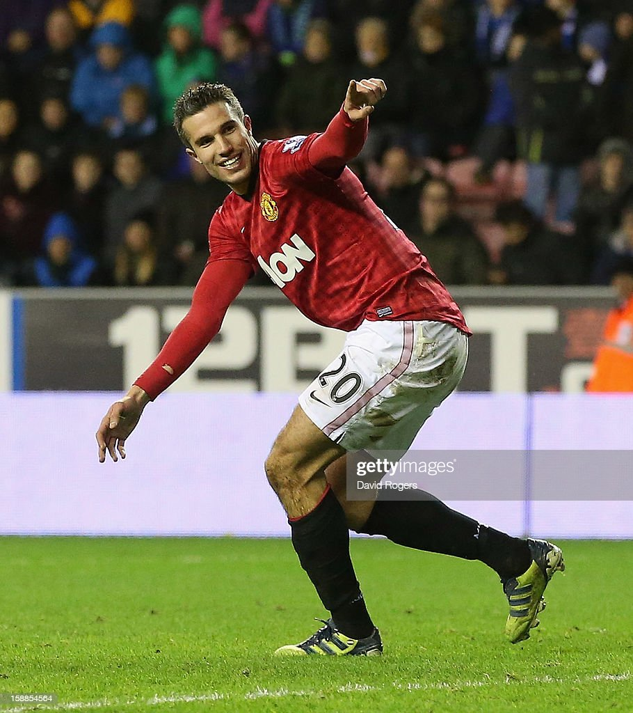 Robin van Persie of Manchester United celebrates after scoring his second goal during the Barclays Premier League match between Wigan Athletic and Manchester United at the DW Stadium on January 1, 2013 in Wigan, England.