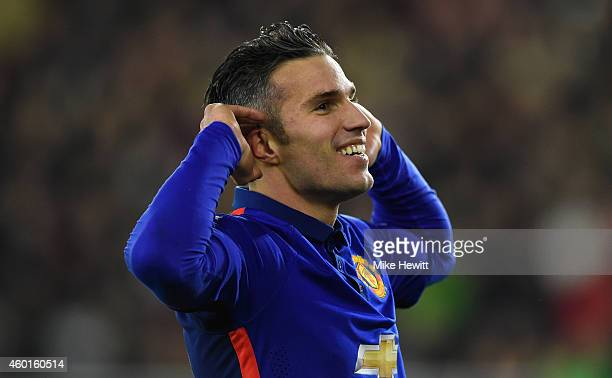 Robin van Persie of Manchester United celebrates after scoring his second goal during the Barclays Premier League match between Southampton and...