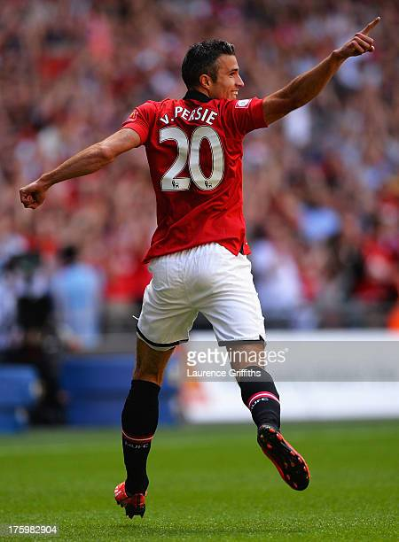 Robin van Persie of Manchester United celebrates after scoring the opening goal during the FA Community Shield match between Manchester United and...
