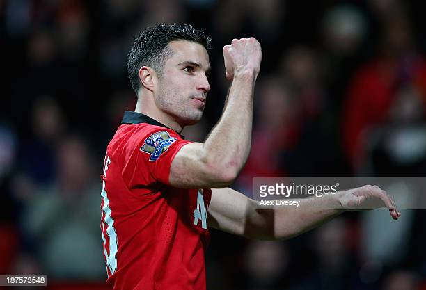 Robin van Persie of Manchester United celebrates at the end of the Barclays Premier League match between Manchester United and Arsenal at Old...