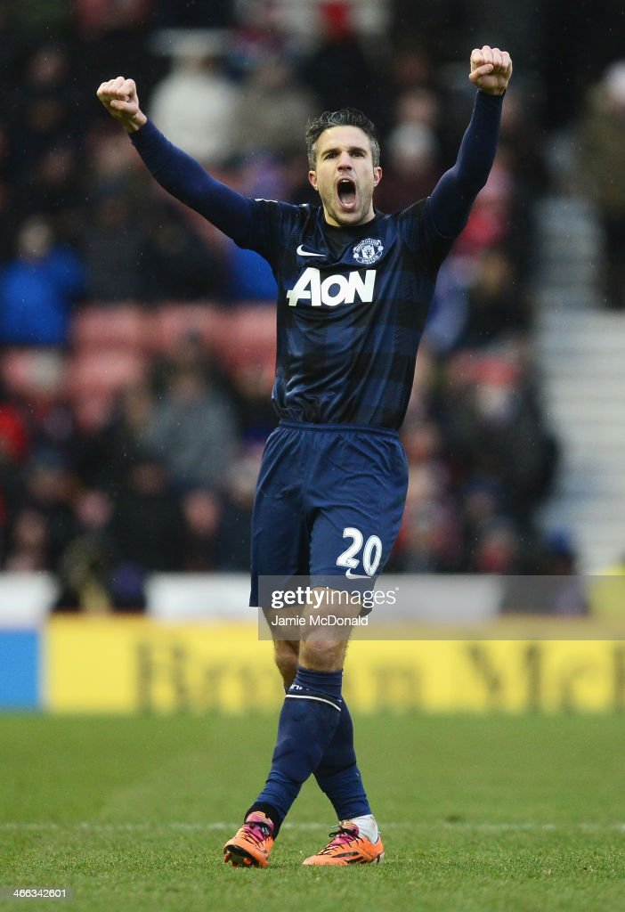 Robin van Persie of Manchester United celebrates his goal during the Barclays Premier League match between Stoke City and Manchester United at...