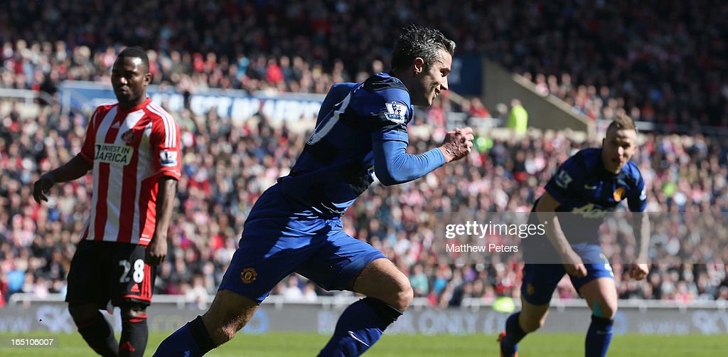 Robin van Persie of Manchester United celebrates his part in Titus Bramble scoring an own-goal during the Barclays Premier League match between Sunderland and Manchester United at Stadium of Light on March 30, 2013 in Sunderland, England.