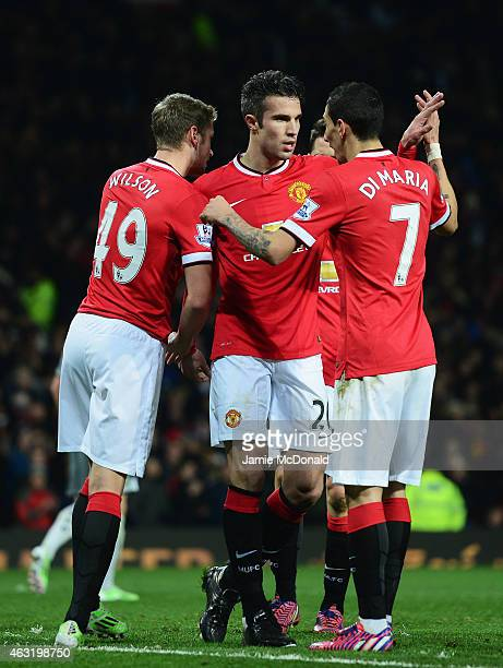 Robin van Persie of Manchester United celebrates his penalty with team mates during the Barclays Premier League match between Manchester United and...
