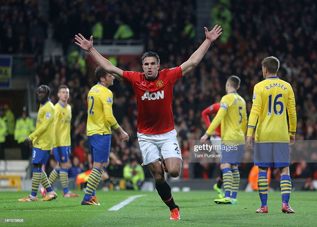 Robin van Persie of Manchester United celebrates s oring their first goal during the Barclays Premier League Match between Manchester United and Arsenal at Old Trafford on November 10, 2013 in Manchester, England.