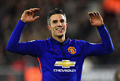 Robin van Persie of Manchester United celebrates scoring his second goal during the Barclays Premier League match between Southampton and Manchester...