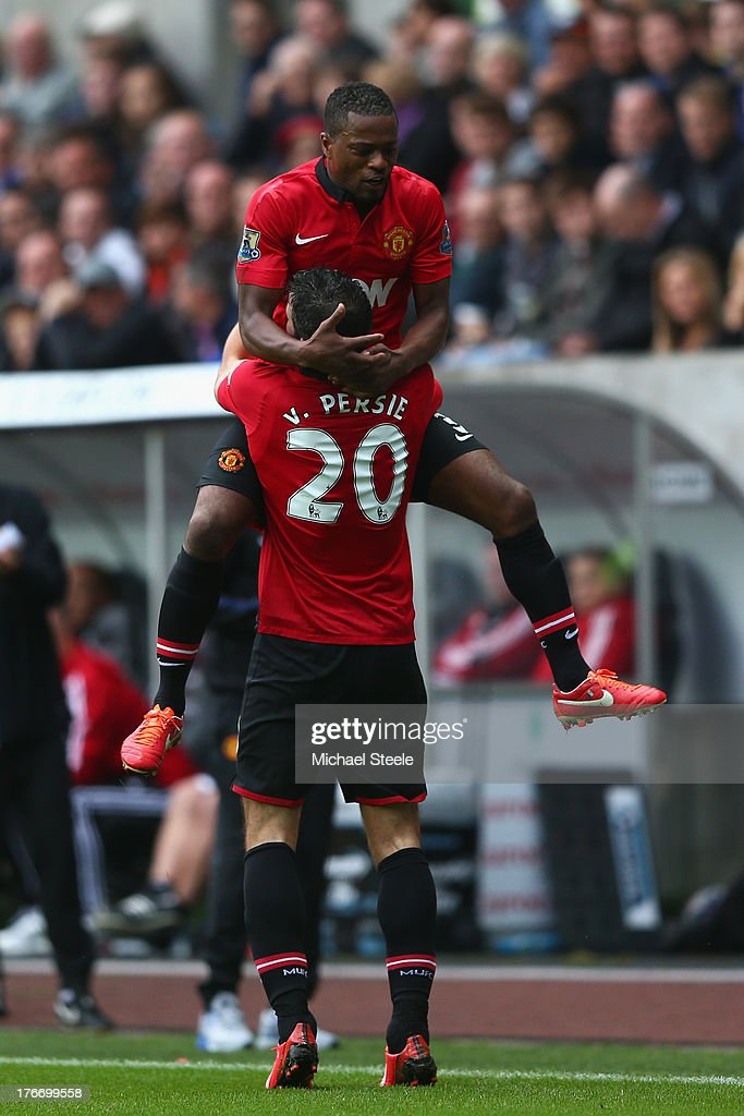 Robin van Persie of Manchester United celebrates scoring his sides third goal with <a gi-track='captionPersonalityLinkClicked' href=/galleries/search?phrase=Patrice+Evra&family=editorial&specificpeople=714865 ng-click='$event.stopPropagation()'>Patrice Evra</a> during the Barclays Premier League match between Swansea City and Manchester United at the Liberty Stadium on August 17, 2013 in Swansea, Wales.