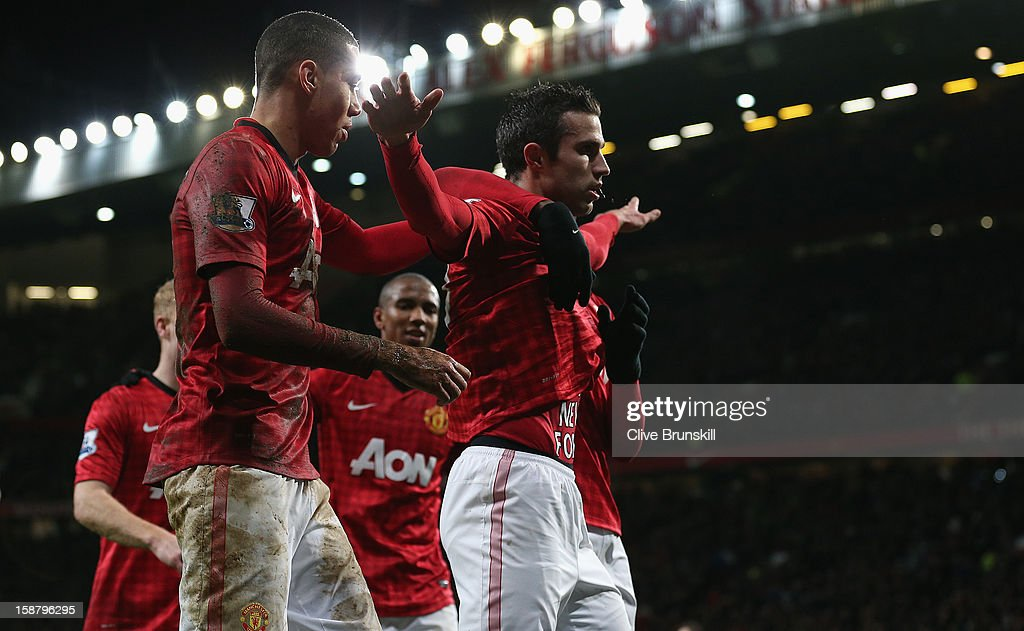 <a gi-track='captionPersonalityLinkClicked' href=/galleries/search?phrase=Robin+van+Persie&family=editorial&specificpeople=214179 ng-click='$event.stopPropagation()'>Robin van Persie</a> of Manchester United celebrates scoring his team's second goal during the Barclays Premier League match between Manchester United and West Bromwich Albion at Old Trafford on December 29, 2012 in Manchester, England.