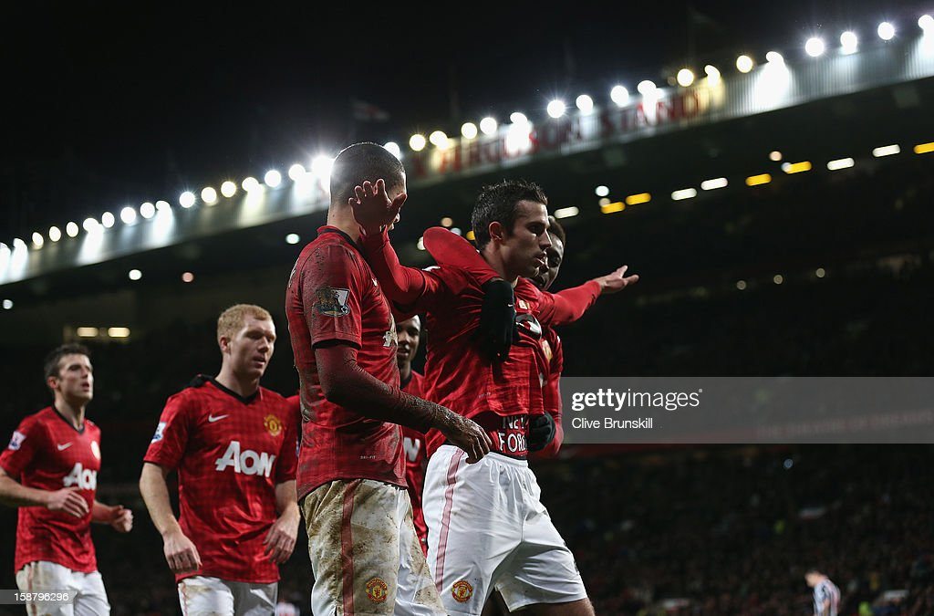 Robin van Persie of Manchester United celebrates scoring his team's second goal during the Barclays Premier League match between Manchester United and West Bromwich Albion at Old Trafford on December 29, 2012 in Manchester, England.
