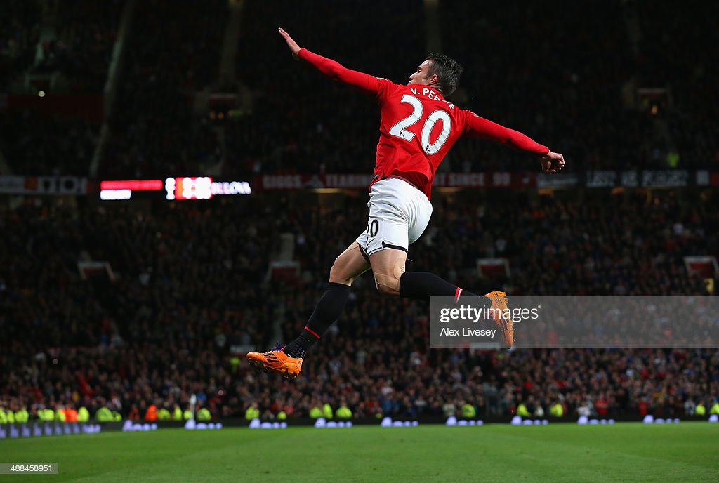 Robin van Persie of Manchester United celebrates scoring his team's third goal during the Barclays Premier League match between Manchester United and Hull City at Old Trafford on May 6, 2014 in Manchester, England.