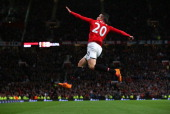 Robin van Persie of Manchester United celebrates scoring his team's third goal during the Barclays Premier League match between Manchester United and...