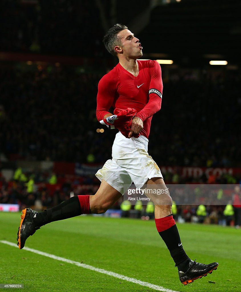 Robin van Persie of Manchester United celebrates scoring the equalising goal during the Barclays Premier League match between Manchester United and...