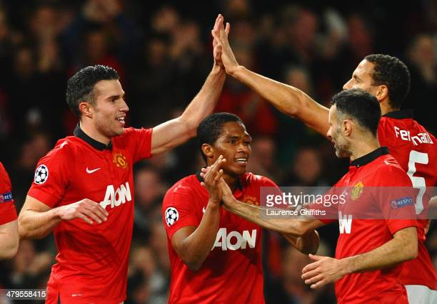 Robin van Persie of Manchester United celebrates scoring the second goal with his teammates during the UEFA Champions League Round of 16 second round...