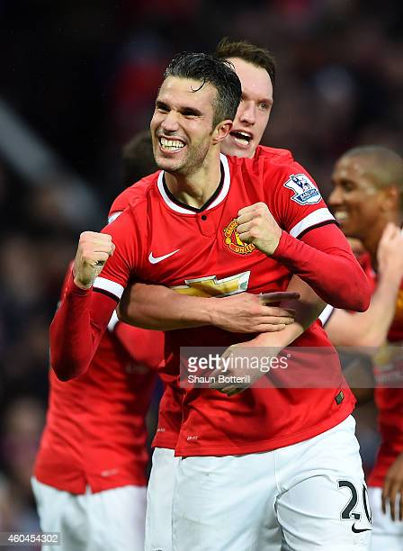 Robin van Persie of Manchester United celebrates scoring the third goal during the Barclays Premier League match between Manchester United and...