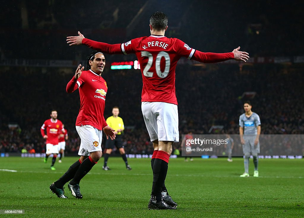 Robin van Persie of Manchester United celebrates scoring the third goal with teammate Radamel Falcao during the Barclays Premier League match between...
