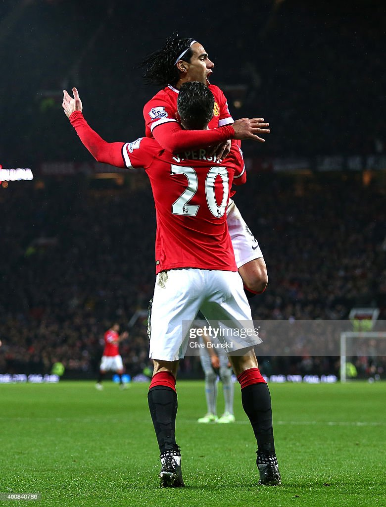 Robin van Persie of Manchester United celebrates scoring the third goal with team-mate Radamel Falcao during the Barclays Premier League match between Manchester United and Newcastle United at Old Trafford on December 26, 2014 in Manchester, England.