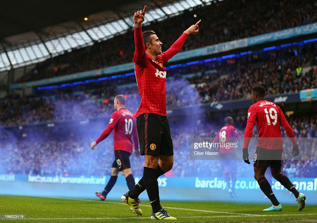 Robin van Persie of Manchester United celebrates scoring the winning goal during the Barclays Premier League match between Manchester City and...