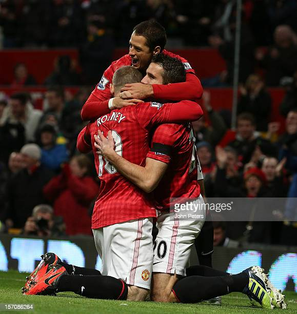 Robin van Persie of Manchester United celebrates scoring their first goal during the Barclays Premier League match between Manchester United and West...