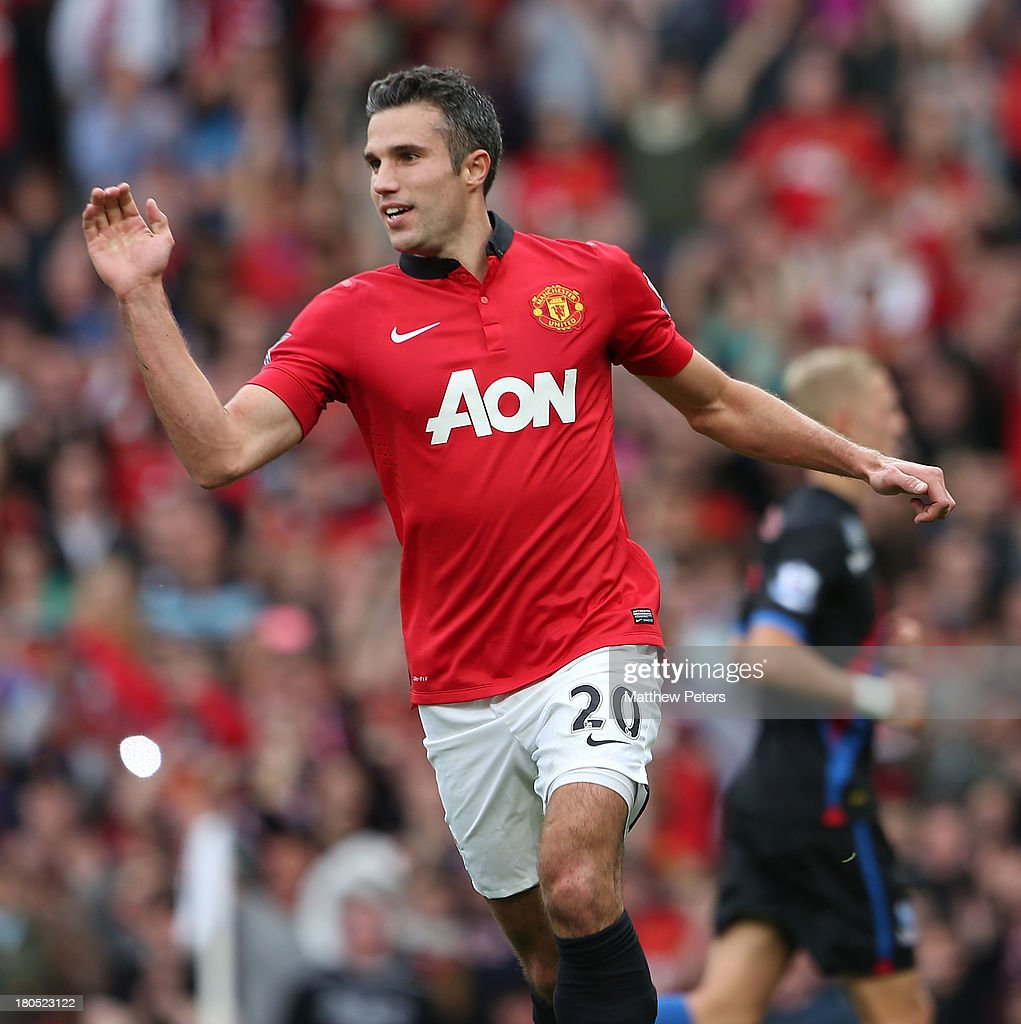 Robin van Persie of Manchester United celebrates scoring their first goal during the Barclays Premier League match between Manchester United and Crystal Palace at Old Trafford on September 14, 2013 in Manchester, England.