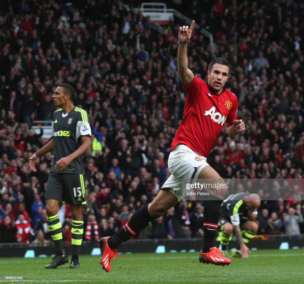 Robin van Persie of Manchester United celebrates scoring their first goal during the Barclays Premier League match between Manchester United and Stoke City at Old Trafford on October 26, 2013 in Manchester, England.