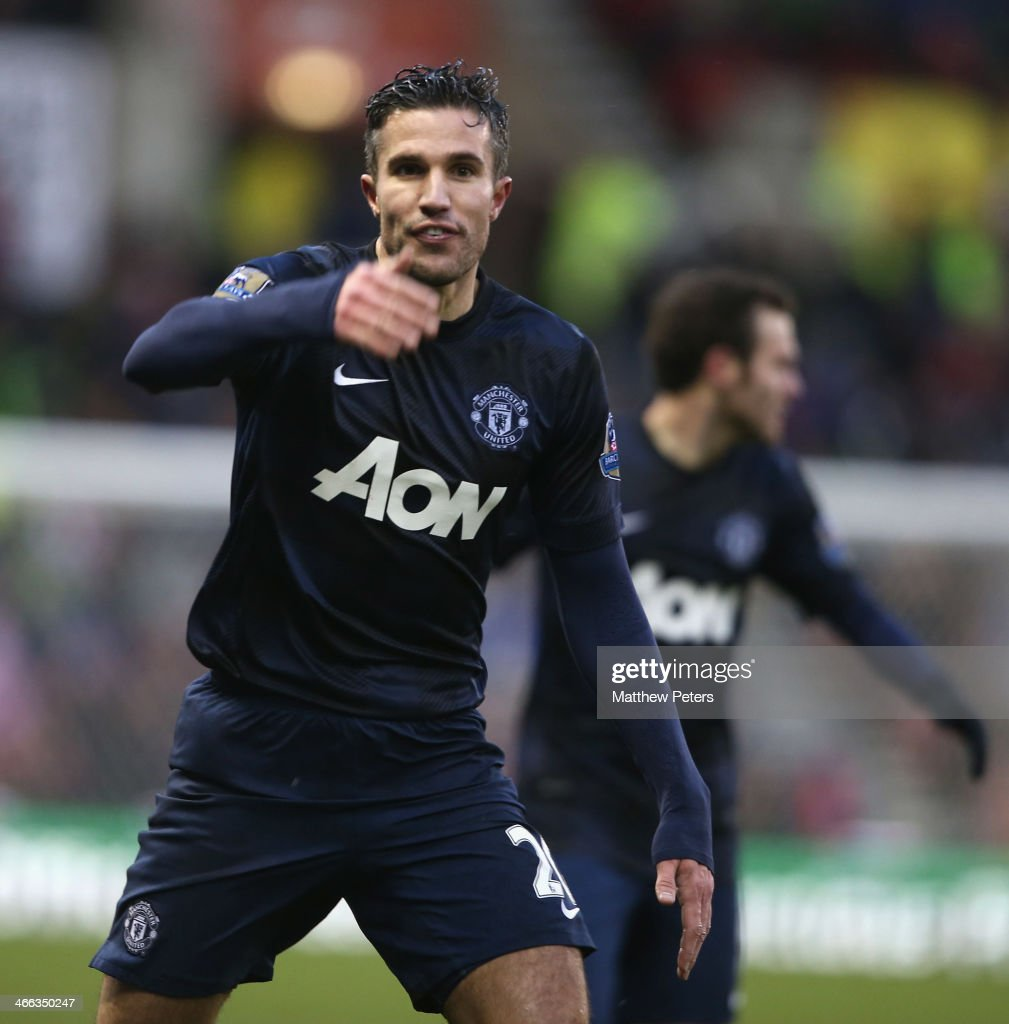 Robin van Persie of Manchester United celebrates scoring their first goal during the Barclays Premier League match between Stoke City and Manchester United at Britannia Stadium on February 1, 2014 in Stoke on Trent, England.