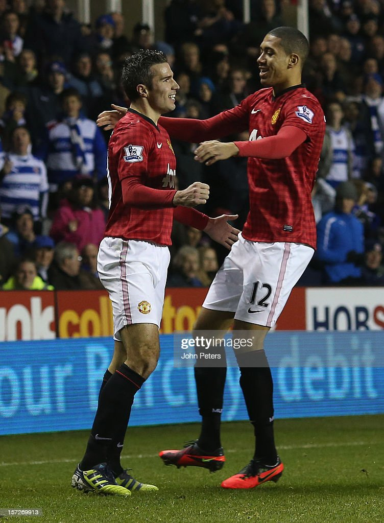 Robin van Persie (L) of Manchester United celebrates scoring their fourth goal during the Barclays Premier League match between Reading and Manchester United at Madejski Stadium on December 1, 2012 in Reading, England.
