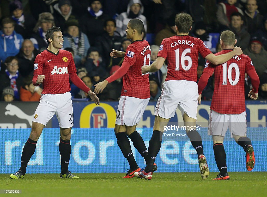 Robin van Persie of Manchester United celebrates scoring their fourth goal during the Barclays Premier League match between Reading and Manchester...