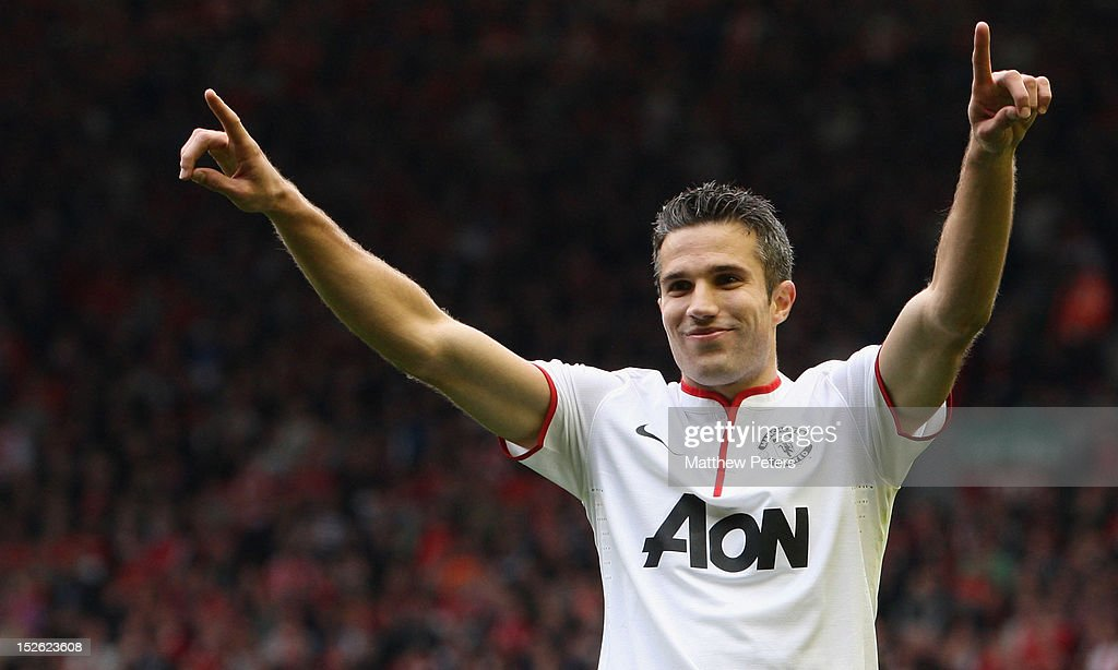 Robin van Persie of Manchester United celebrates scoring their second goal during the Barclays Premier League match between Liverpool and Manchester United at Anfield on September 23, 2012 in Liverpool, England.