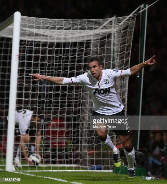 Robin van Persie of Manchester United celebrates scoring their second goal during the Barclays Premier League match between West Ham United and...