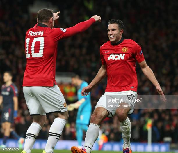 Robin van Persie of Manchester United celebrates scoring their second goal during the UEFA Champions League Round of 16 second leg match between...