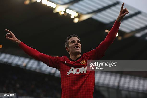 Robin van Persie of Manchester United celebrates scoring their third goal during the Barclays Premier League match between Manchester City and...