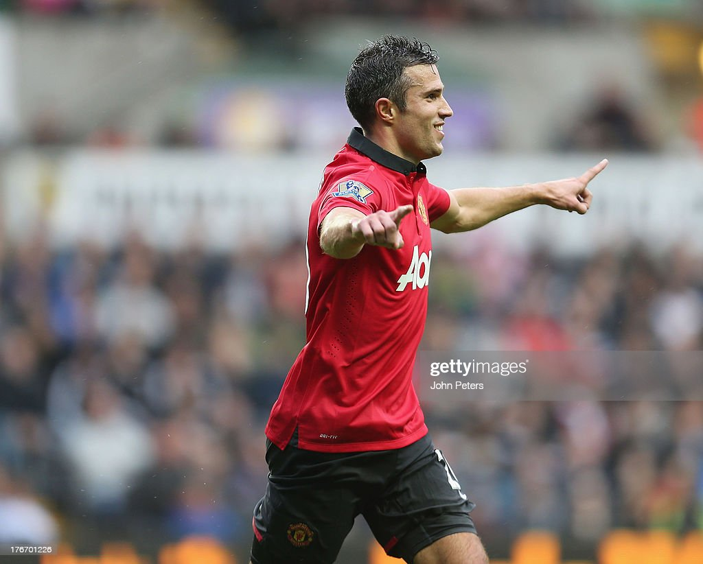 Robin van Persie of Manchester United celebrates scoring their third goal during the Barclays Premier League match between Swansea City and Manchester United at the Liberty Stadium on August 17, 2013 in Swansea, Wales.