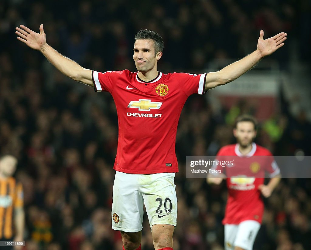 Robin van Persie of Manchester United celebrates scoring their third goal during the Barclays Premier League match between Manchester United and Hull...