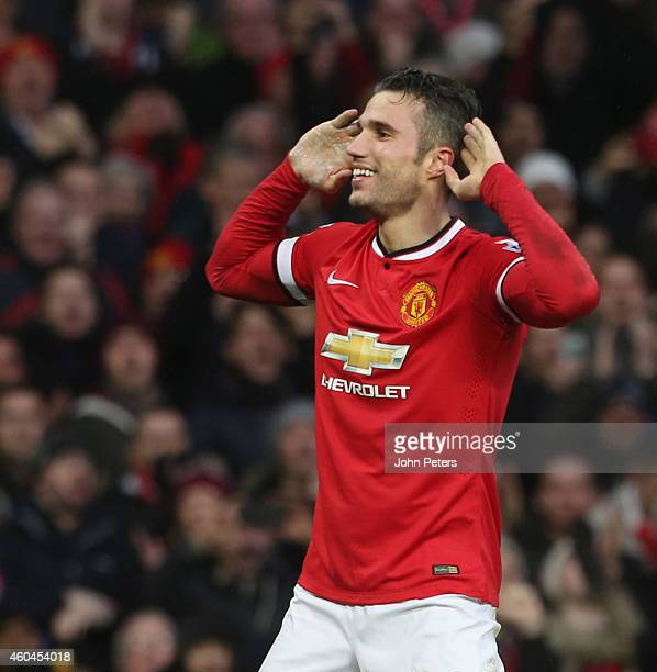 Robin van Persie of Manchester United celebrates scoring their third goal during the Barclays Premier League match between Manchester United and...