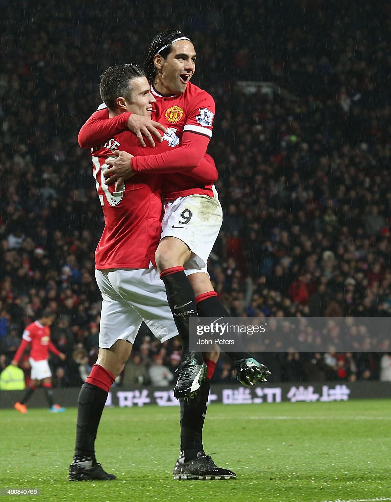Robin van Persie of Manchester United celebrates scoring their third goal during the Barclays Premier League match between Manchester United and Newcastle United at Old Trafford on December 26, 2014 in Manchester, England.