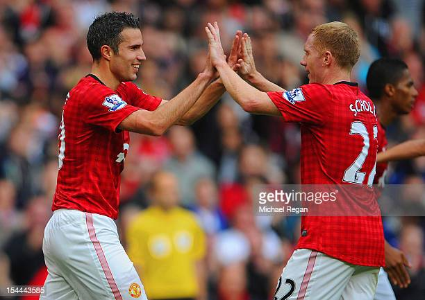 Robin van Persie of manchester United celebrates scoring to make it 21 with Paul Scholes during the Barclays Premier League match between Manchester...
