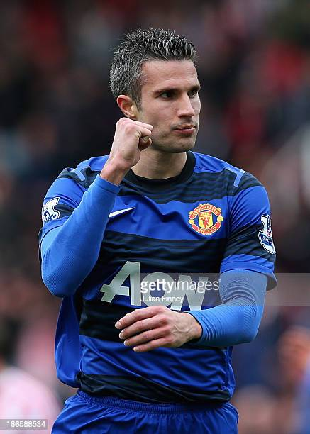 Robin van Persie of Manchester United celebrates victory at the end of the Barclays Premier League match between Stoke City and Manchester United at...