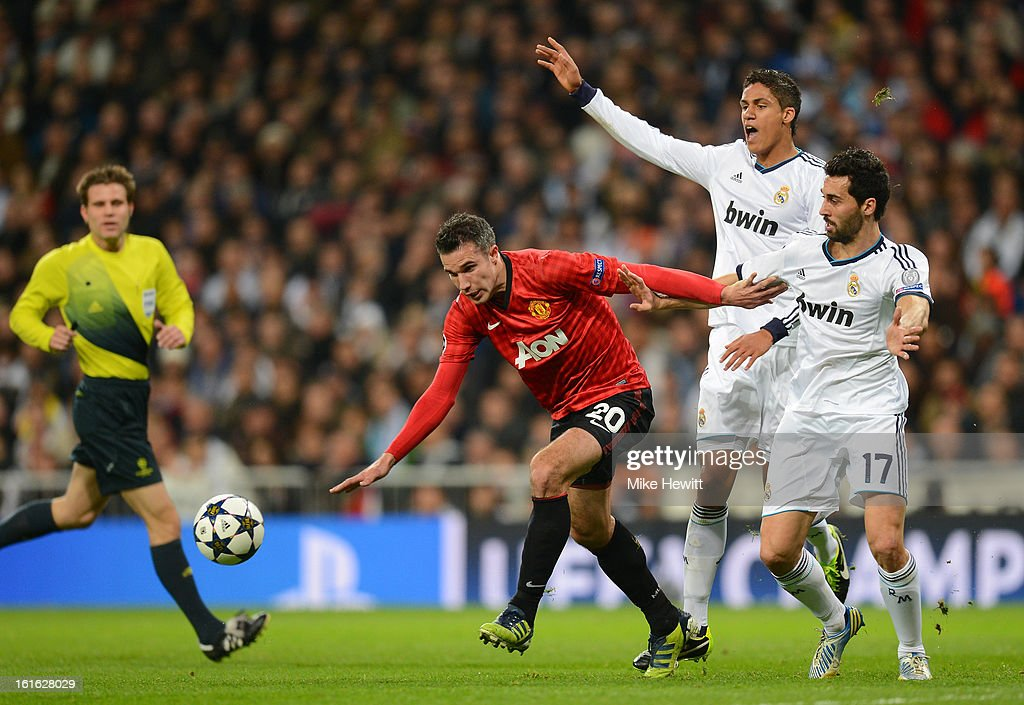 Robin van Persie of Manchester United clashes with Alvaro Arbeloa of Real Madrid during the UEFA Champions League Round of 16 first leg match between Real Madrid and Manchester United at Estadio Santiago Bernabeu on February 13, 2013 in Madrid, Spain.
