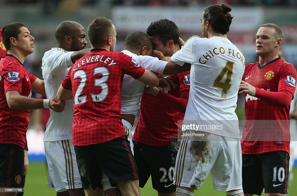Robin van Persie of Manchester United clashes with Ashley Williams of Swansea City during the Barclays Premier League match between Swansea City and Manchester United at Liberty Stadium on December 23, 2012 in Swansea, Wales.