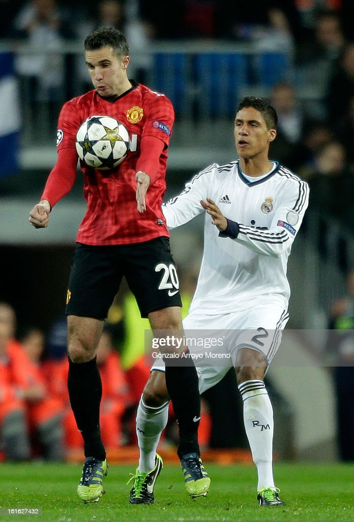 Robin van Persie of Manchester United control the ball as Raphael Varane of Real Madrid marshalls him during the UEFA Champions League Round of 16 first leg match between Real Madrid and Manchester United at Estadio Santiago Bernabeu on February 13, 2013 in Madrid, Spain.