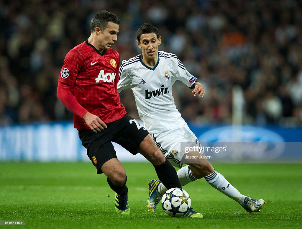 Robin van Persie (L) of Manchester United duels for the ball with Angel Di Maria of Real Madrid during the UEFA Champions League Round of 16 first leg match between Real Madrid and Manchester United at Estadio Santiago Bernabeu on February 13, 2013 in Madrid, Spain.