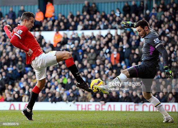 Robin van Persie of Manchester United has his attempt on goal saved by goalkeeper Hugo Lloris of Spurs during the Barclays Premier League match...