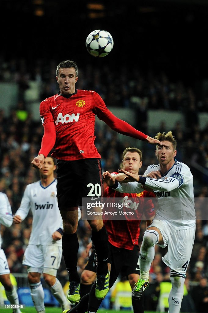 Robin van Persie of Manchester United heads the ball during the UEFA Champions League Round of 16 first leg match between Real Madrid and Manchester United at Estadio Santiago Bernabeu on February 13, 2013 in Madrid, Spain.