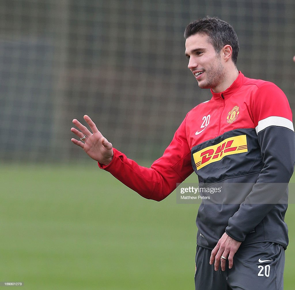 Robin van Persie of Manchester United in action during a first team training session at Carrington Training Ground on January 11, 2013 in Manchester, England.
