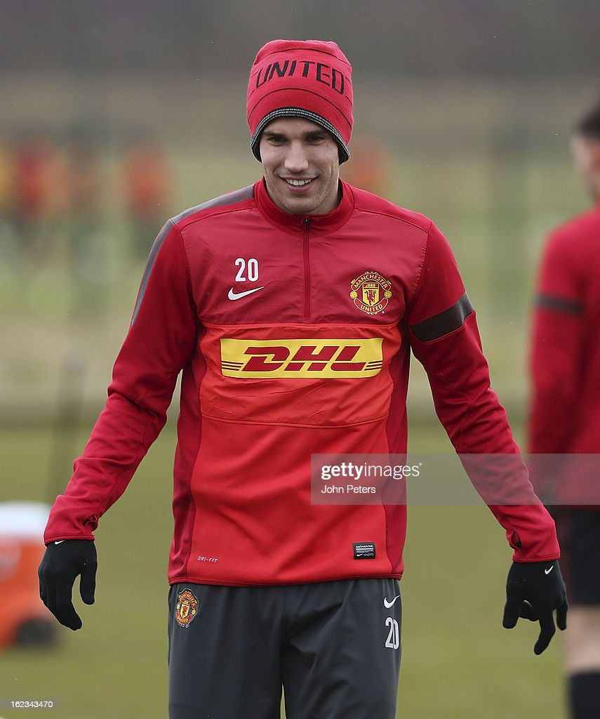 Robin van Persie of Manchester United in action during a first team training session at Carrington Training Ground on February 22, 2013 in Manchester, England.