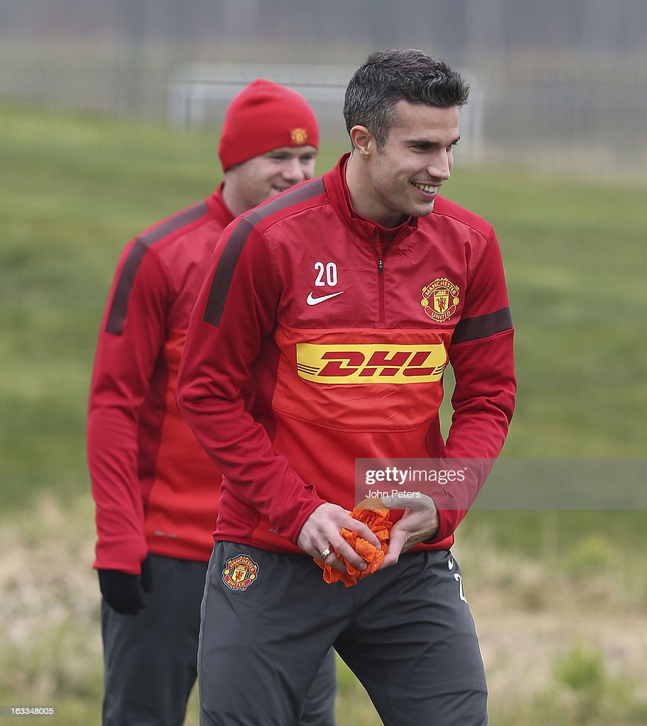 Robin van Persie of Manchester United in action during a first team training session at Carrington Training Ground on March 8, 2013 in Manchester, England.