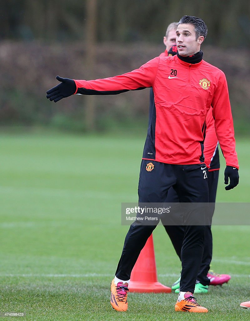 Robin van Persie of Manchester United in action during a first team training session, ahead of their UEFA Champions League Round of 16 match against Olympiacos, at Aon Training Complex on February 24, 2014 in Manchester, England.